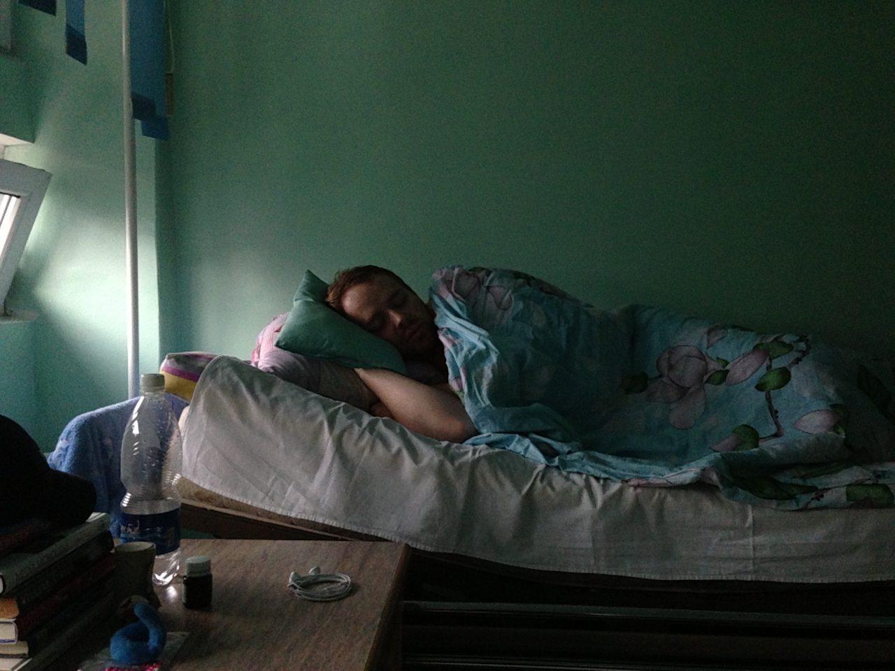 Judson recovering in a Bishkek hospital bed after having an appendectomy in Bishkek.