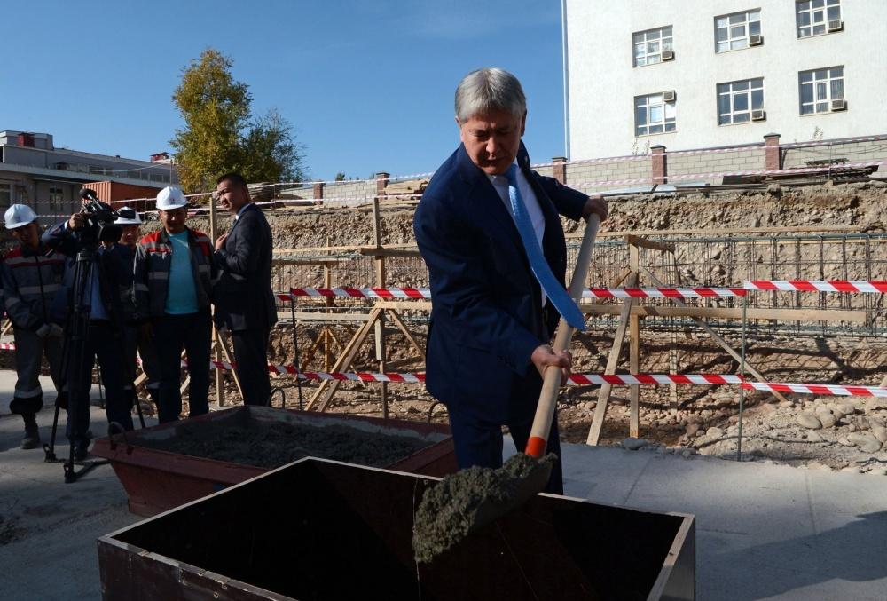 President Almazbek Atambayev of Kyrgyzstan breaks ground on a new medical facility.